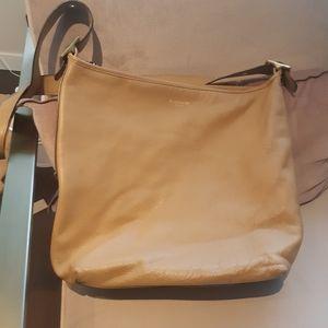 🦄 3/ $60 Coach natural leather bucket handbag